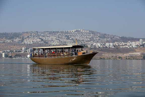 Tiberias  is a city on the western shore of the Sea of Galilee. The picture shows a Pilgrim' s boat on the lake. Photo by Itamar Grinberg.