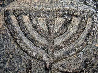 Stone relief menorah & ram's horn, Golan